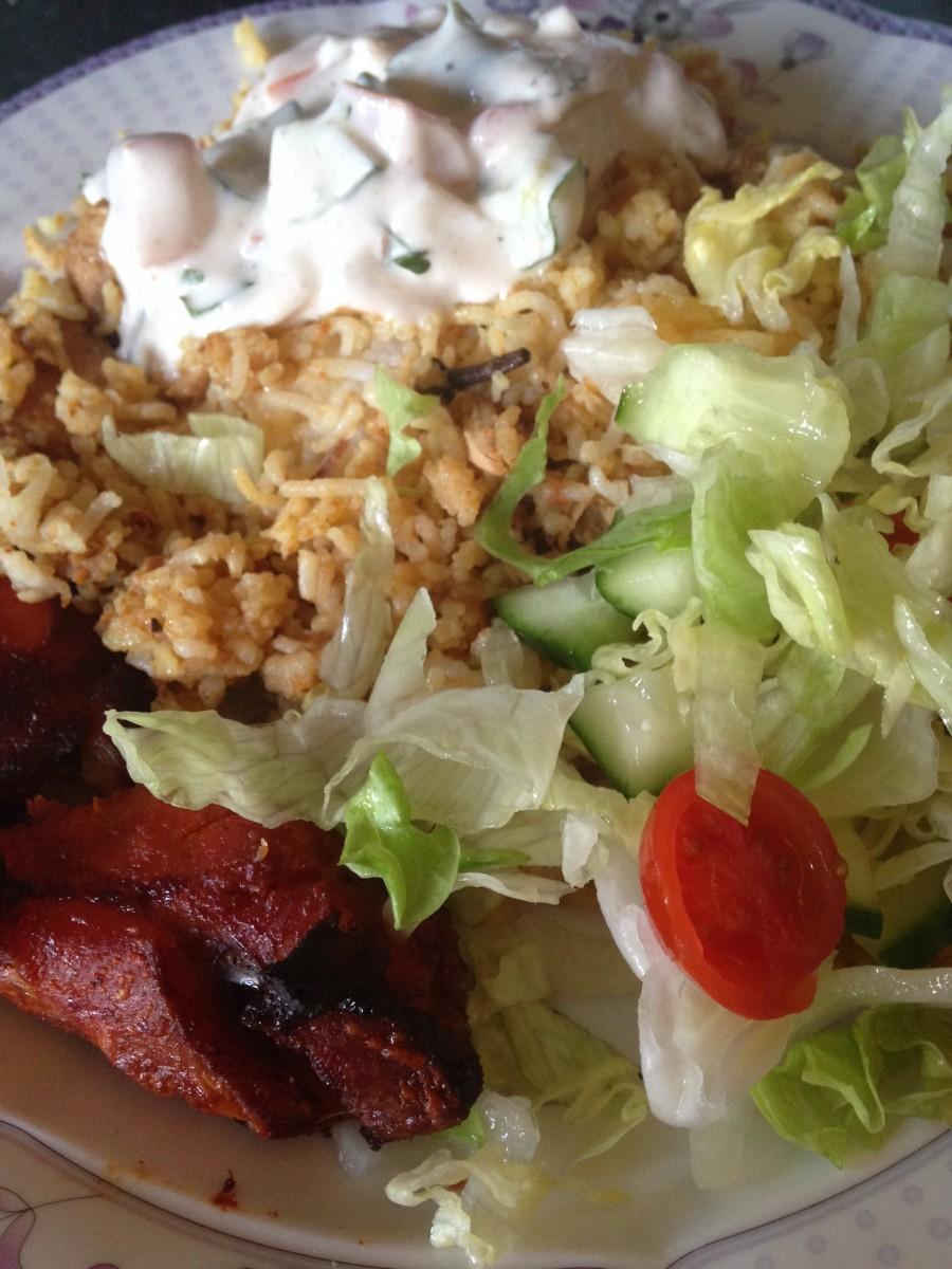 Chicken legs, Chicken Biryani, Salad and Raita