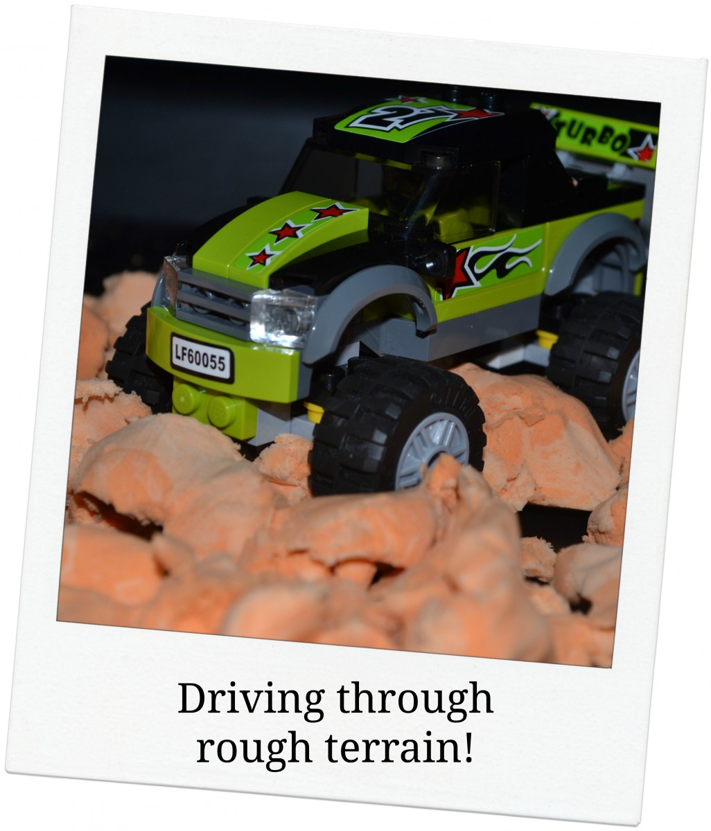 Lego Monster Truck driving through Moonsand