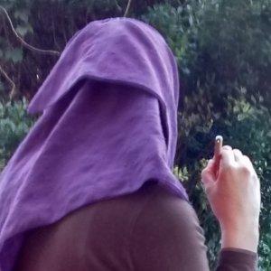 Elizabeth Lymer pen in hand back of head