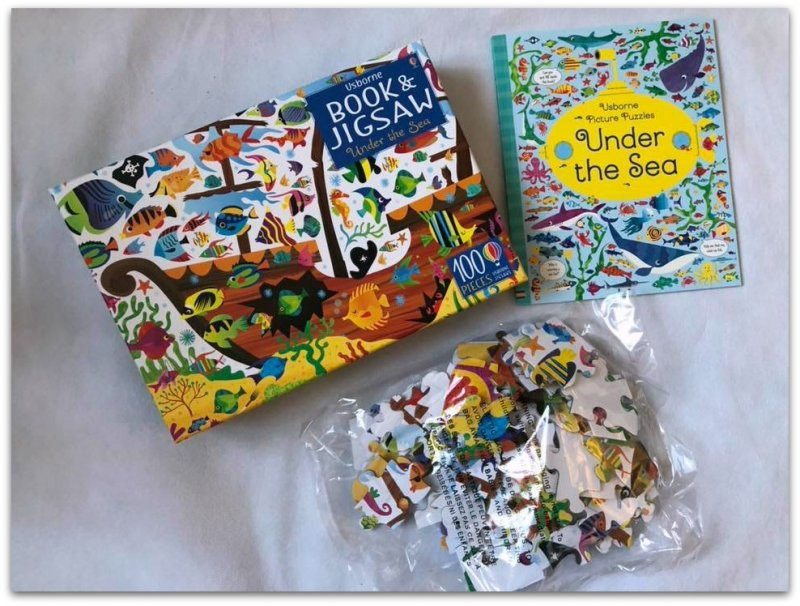 Picture of book and puzzle pieces