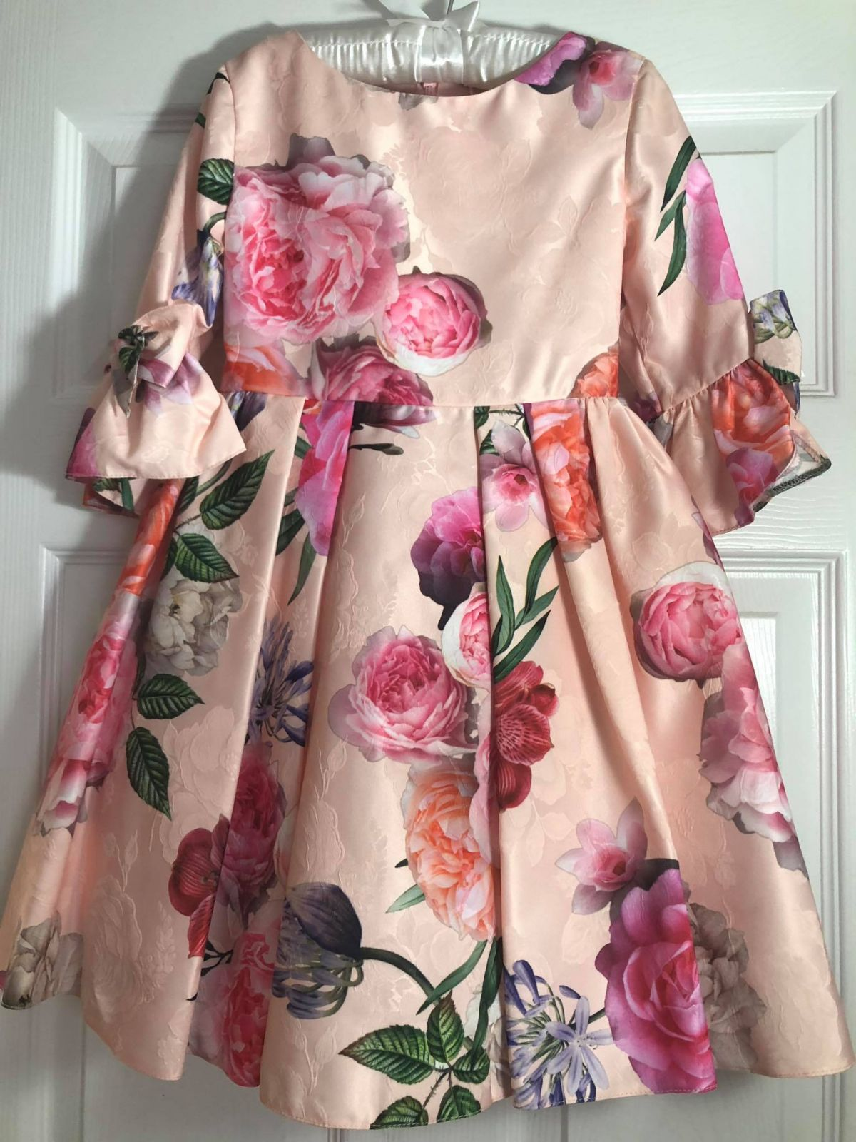 David Charles Pink Peony dress on a hanger