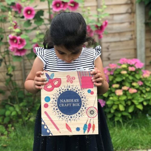 Child holding personalised craft box from Happiness is a Gift