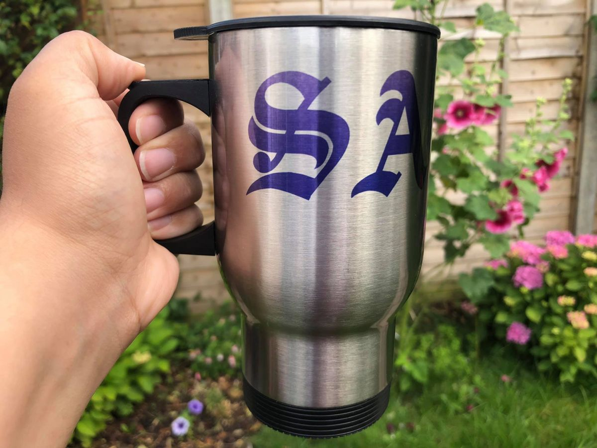 Personalised travel mug with SA initials